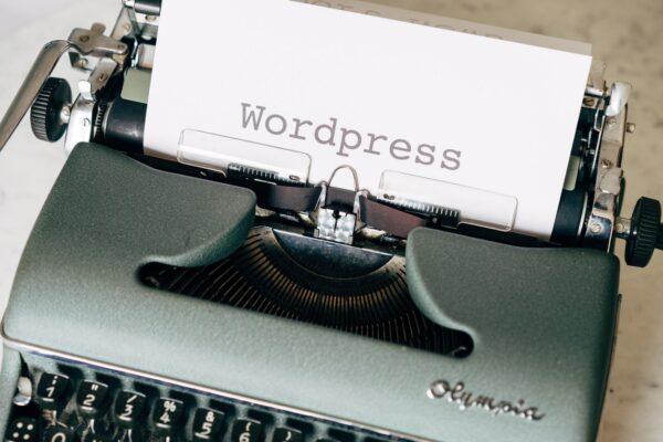 black typewriter on green table